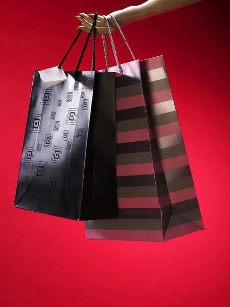 Free Time Holiday Season Icon Paper Bag Buying Consumerism Expenses Hanging Leisure Activity Luxury Red Retail  Shopping Bag Spending Studio Shot Symbol