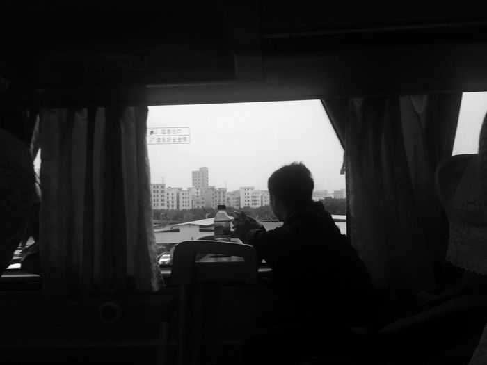 Man Looking Through Window While Traveling In Train