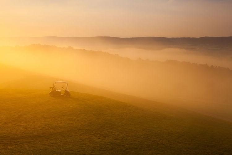 Morning on the golf course Golfing Hills Misty Nature Beauty In Nature Field Fog Golden Hour Golf Cart Golf Club Golf Course Grass Landscape Misty Morning Nature No People Outdoors Scenics Sky Sport Sunset