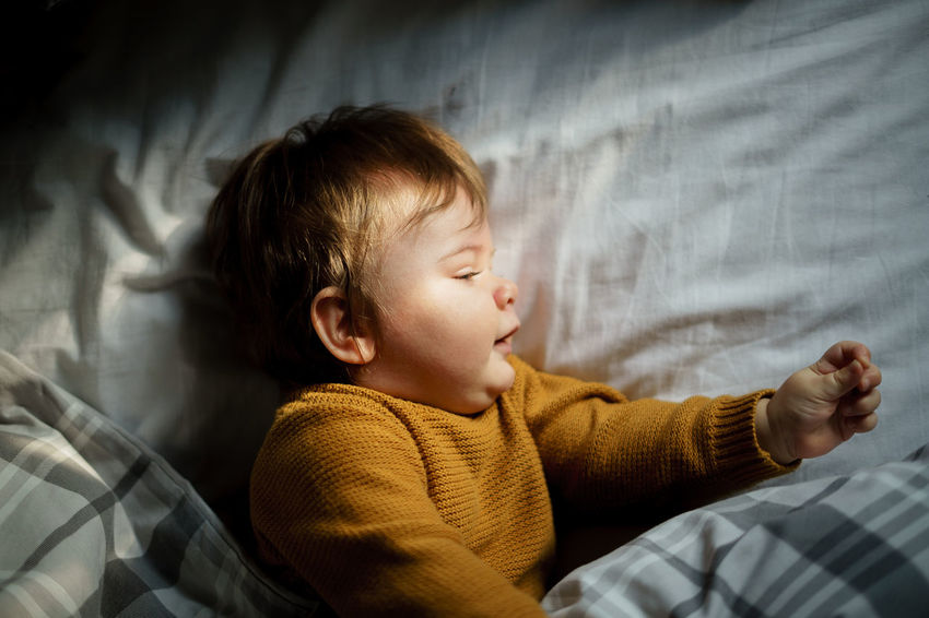 Babyboy Bed Domestic Life Innocence Sunlight Babies Of Eyeem Babies Only Babyhood Bedroom Blonde Hair Childhood Cute Home Interior Indoors  Linen Lying Down Relaxation Sheet Sleeping Son Sunlight, Shades And Shadows Toddler  Wakeup White Linen Yellow Color