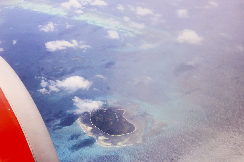 Island INDONESIA IslandView Makassar Aerial View Air Vehicle Airplane Airplane Wing BeautifulIndonesia Beauty In Nature Beauty In Nature Blue Bluesea Cloud - Sky Day Flying Island Nature No People Outdoors Scenics Sea Sky Transportation Vehicle Part Water