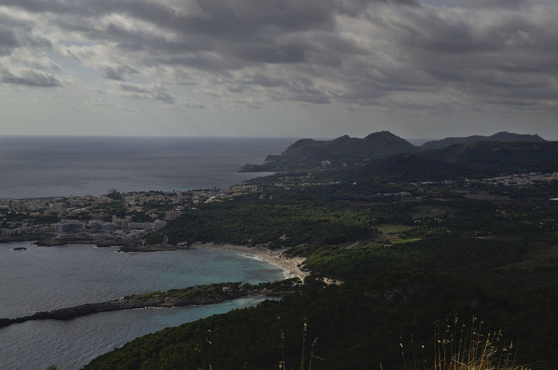 Scenic view of cala agulla against sky