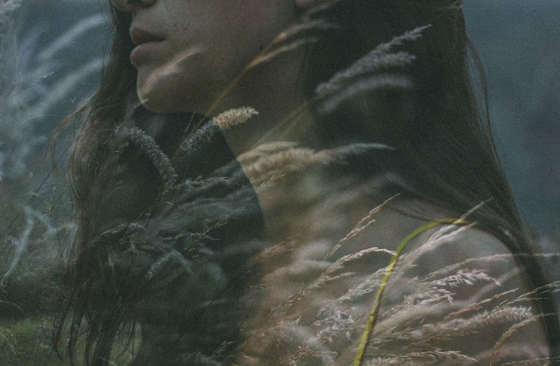 Double exposure of woman and grass
