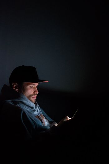 Night portrait Work Home Cellphone Snapback Fashion Beard Man Light Nightphotography Night Portrait Photography Portrait Only Men One Man Only One Person Adults Only Adult Mature Adult Technology People Lifestyles Indoors  Black Background Film Industry