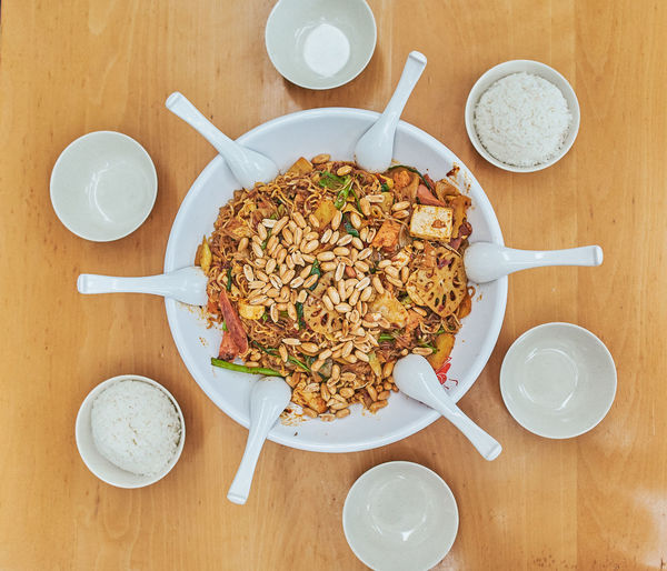 Communal Eating Chinese Food Food And Drink Food Table Kitchen Utensil Eating Utensil Freshness Directly Above Spoon Ready-to-eat Meal Wellbeing High Angle View Still Life Drink Healthy Eating Refreshment Indoors  Breakfast Plate No People Glass Table Knife Togetherness