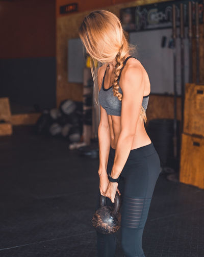 Athlete Athletic Determination Exercising Kettlebells Motivation Portrait Of A Woman Active Lifestyle  Blond Hair Cross Training Crossfit Energy Fitness Fitnessmodel Healthy Lifestyle One Person Real People Sport Sport Clothing Stretching Strong Woman Weightlifting Workout Young Woman Young Women