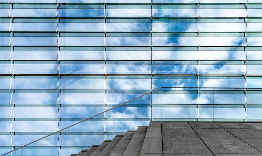 Glass - Material Reflection Cloud - Sky Symmetry Minimalism Minimalistic Wall - Building Feature Best Of Stairways Krull&Krull Images Futuristic Outside Architecture Built Structure Day Pattern No People Low Angle View Staircase Building Building Exterior Steps And Staircases Outdoors Railing Sunlight Full Frame Window Office Building Exterior Transparent Modern Skyscraper My Best Photo