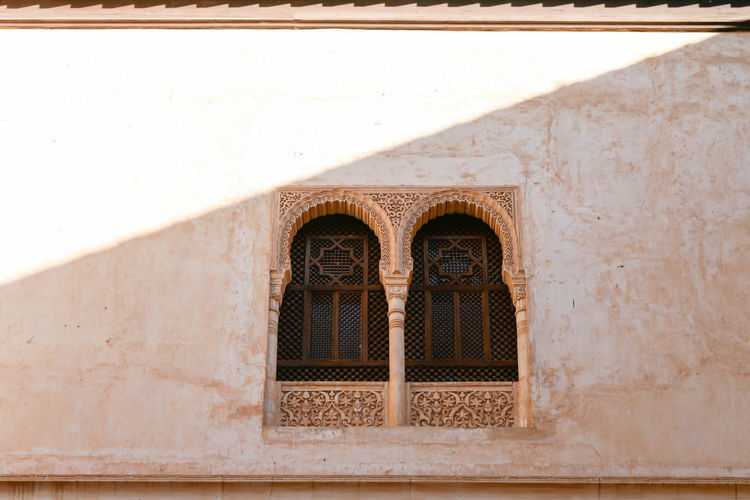 Alhambra Palace Window Alhambra De Granada  Moorish Architecture Alhambra Arch Architectural Column Architecture Building Building Exterior Built Structure Day Design Low Angle View Moorish No People Old Ornate Outdoors Pattern Shadow Sunlight Travel Destinations Wall Wall - Building Feature White Color Window