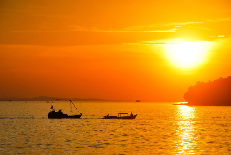 Sunset Sea Silhouette Scenics Beauty In Nature Gold Colored Stockphoto Tropical Climate EyeEm Best Edits Orange Color EyeEm Selects Vacations Sailing Ship Ship Travel Destinations Penyengat Island Travel Boats⛵️Sea Life Decorative Ship Landscape Eyeem Select PenyengatIsland EyeEmNewHere Tourism