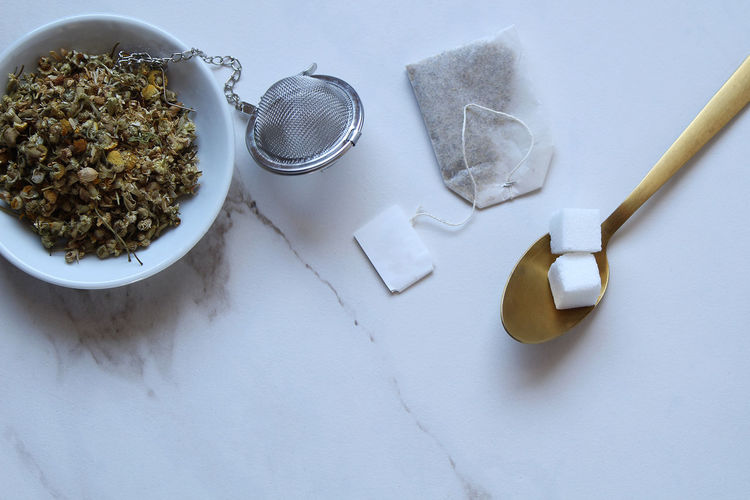 Tea time Chamomile Copy Space Herb Hot Beverage Tea Break Bowl Breakfast Close-up Directly Above Eating Utensil Food And Drink High Angle View Indoors  Kitchen Utensil Loose Tea Marble No People Preparation  Spoon Still Life Studio Shot Table