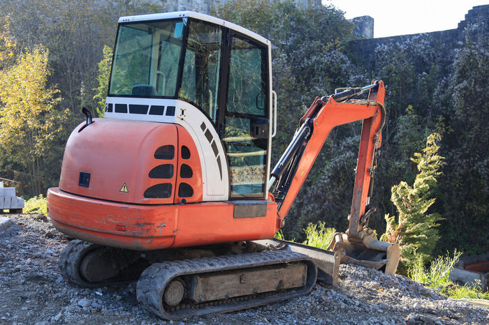 Small excavator on construction site Bucket Construction Machinery Construction Site Construction Vehicle Digger Dirt Earth Equipment Excavation Excavator Hydraulic Industrial Machine Machinery Mini No People Outdoors Power Road Construction Shovel Small Tool Transportation Vehicle Work