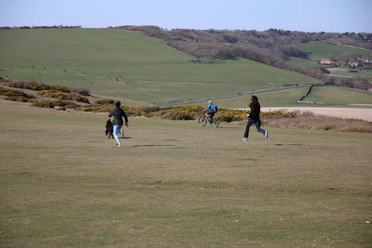 Adults Only Agility Birling Gap Countryside Cycling Cyclist Day Dog Downhill Full Length Healthy Lifestyle Landscape Leisure Activity Outdoors People Rear View Rivalry Running Sport Sportsman Sussex Downs Togetherness