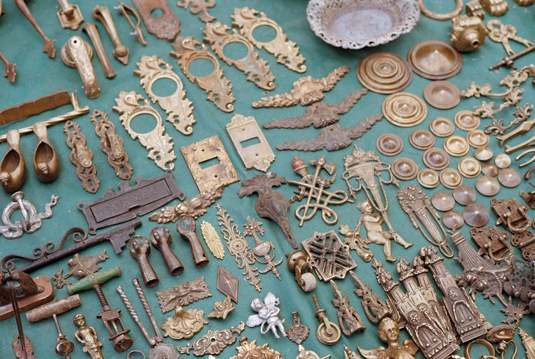 High angle view of various antique objects for sale