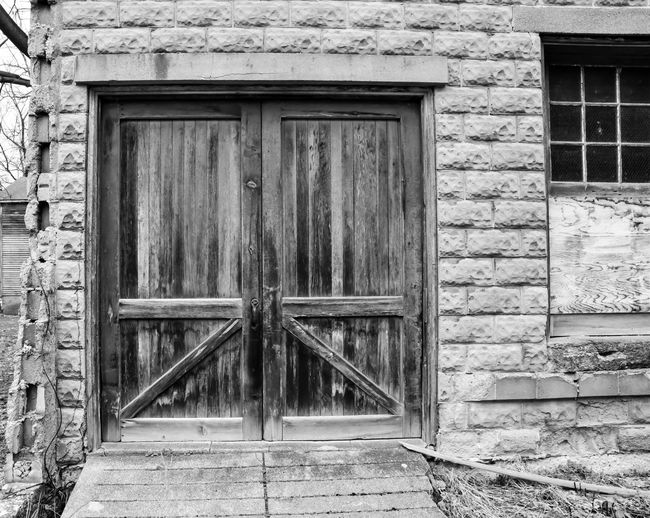 weathered wood barn door Bradley Olson Bradleywarren Photography Backgrounds Background No People Room For Text Room For Copy Copy Space Copyspace Vintage Old Weathered Weathered Metal Weathered Wood Old-fashioned Antique Built Structure Architecture Building Exterior Day Outdoors Door Closed Entrance Building Wood - Material House Security Safety Protection Window Wall Wall - Building Feature Residential District Stone Wall