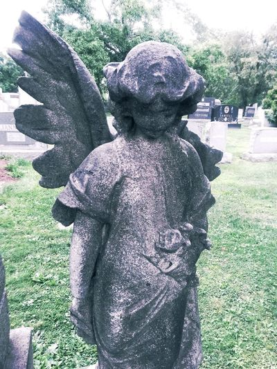 Angel Statue in a Cemetery. Photography