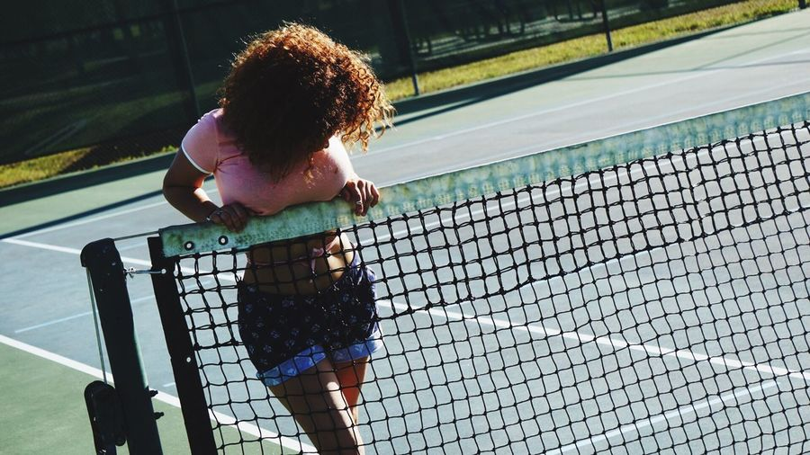 Woman Behind Tennis Net