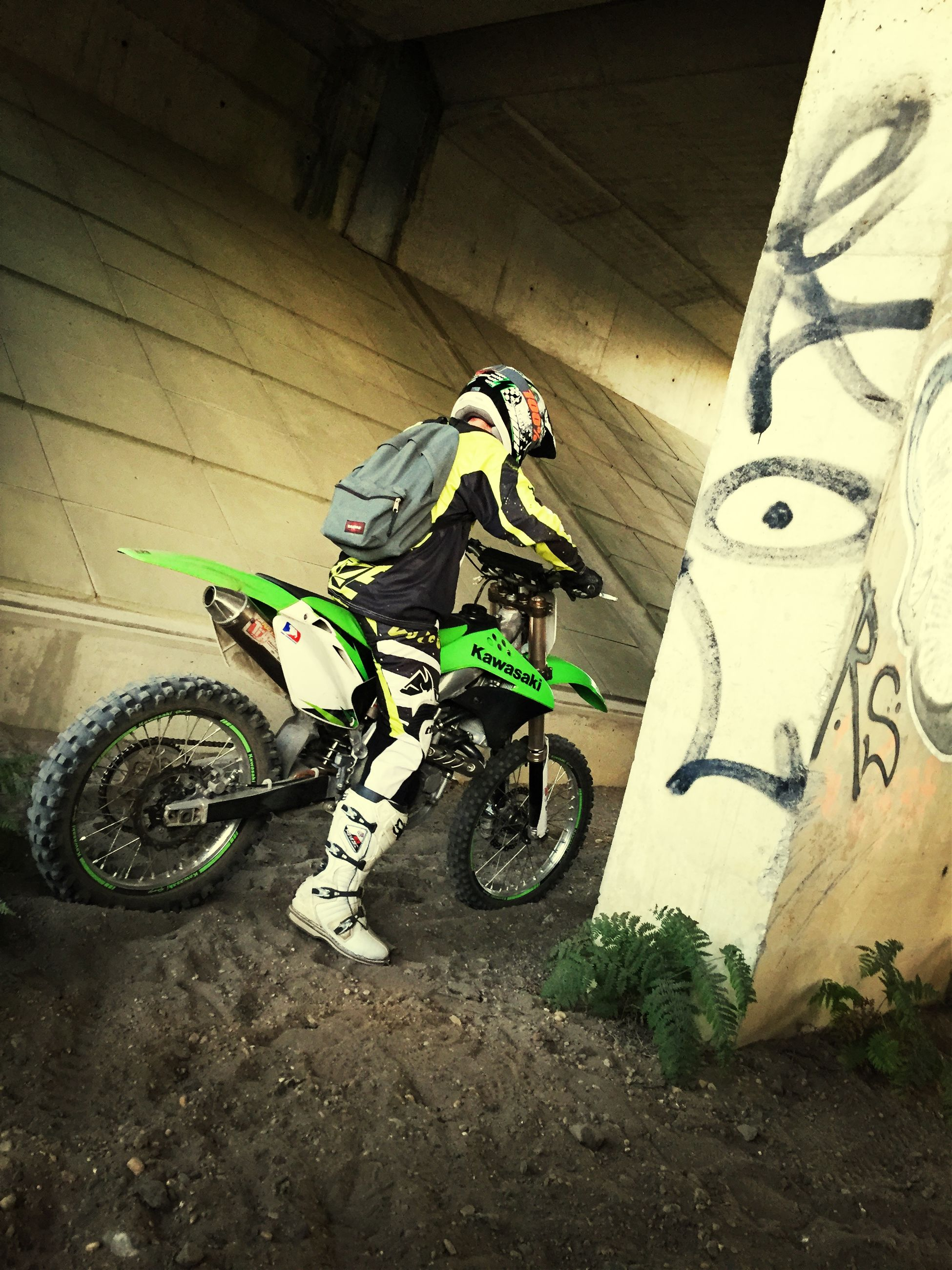bicycle, transportation, land vehicle, mode of transport, high angle view, stationary, parking, street, parked, motorcycle, wall - building feature, day, outdoors, sunlight, no people, riding, graffiti, shadow, shoe, wheel