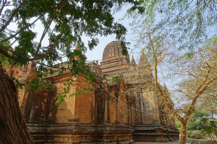 Bagan, Myanmar #asia #Bagan #Myanmar Ancient Ancient Civilization Architecture Building Exterior Built Structure Clear Sky Day History Low Angle View Nature No People Old Ruin Outdoors Place Of Worship Religion Sky Spirituality Tourism Travel Destinations Tree