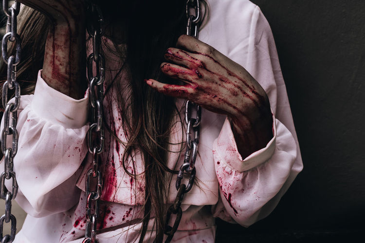 Midsection Of Woman With Blood On Hands