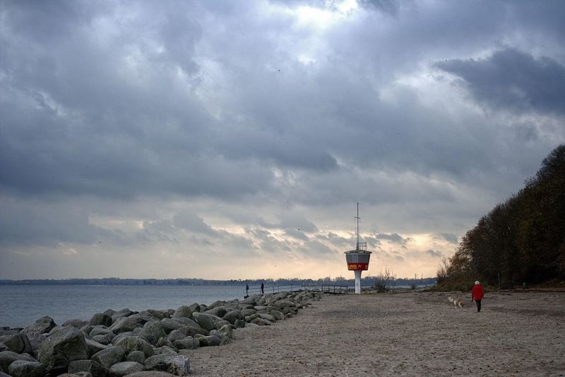 Cloud - Sky Sky Water Nature Tower Sea Direction Land Beauty In Nature Scenics - Nature Beach Overcast Real People Tranquil Scene Guidance Lighthouse