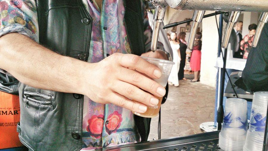 Man holding disposable glass under soda machine