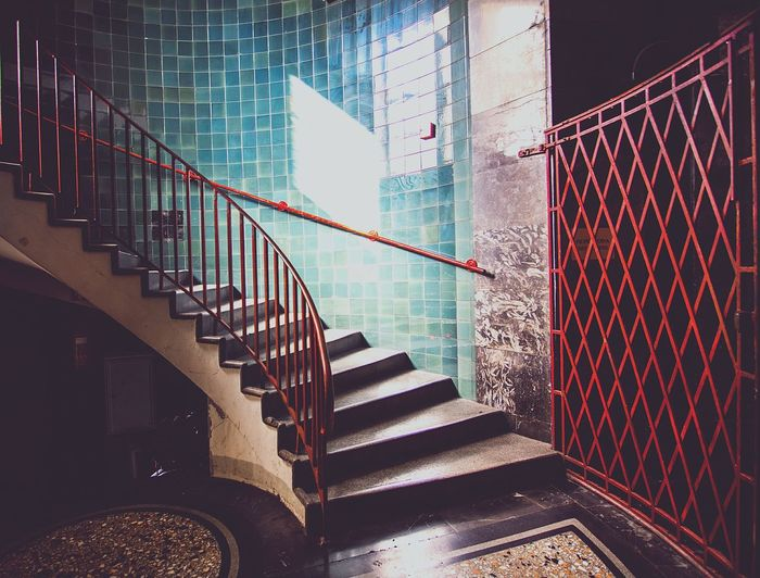 Staircase against tiled wall in old house