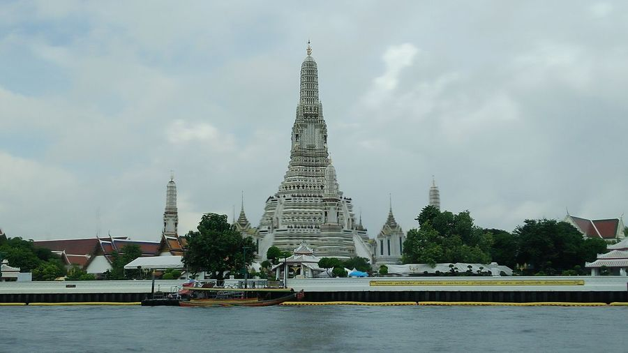 wat arun thailand at chaopraya riverside 27-6-2018 - 1 Temple Temple - Building Templephotography Temple In Thailand Temple Art Riverside River View Riverside Photography Riverview River Side City Cityscape Urban Skyline Water Skyscraper History Arts Culture And Entertainment Business Finance And Industry Monument