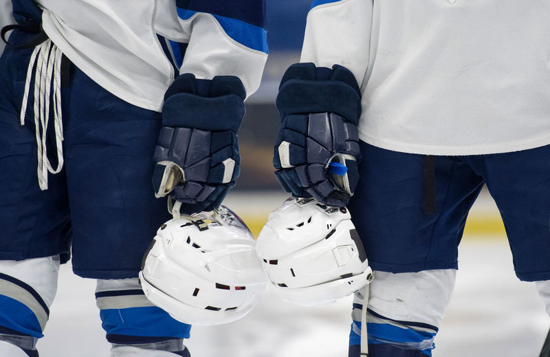 Two Hockey team mates lined up the blue line during the national anthem Blackandwhite Blue Competition Glove Headwear Helmet Hockey Hockey Life Hockey Player I Jersey Men People Protection Real People Reflection Sport Sports Uniform Standing Teamwork Togetherness Uniform