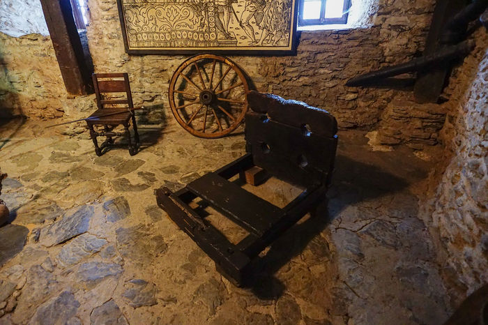 dungeon, punishment instruments in Marksburg Castle Abandoned Absence Architecture Blocks Built Structure Chair Chair Damaged Devices Empty High Angle View Indoors  Marksburg Castle Medieval Obsolete Old Old-fashioned Punishent Shadow Sunlight Torture Wall Wall - Building Feature Weights Wheel