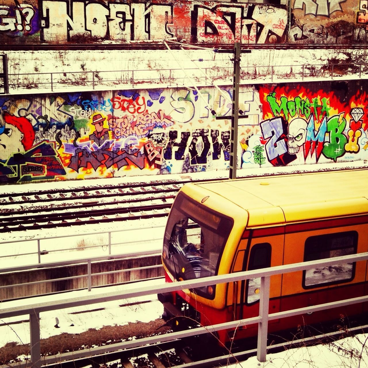graffiti, rail transportation, transportation, multi colored, art and craft, railroad track, mode of transport, public transportation, train - vehicle, day, built structure, communication, no people, architecture, outdoors