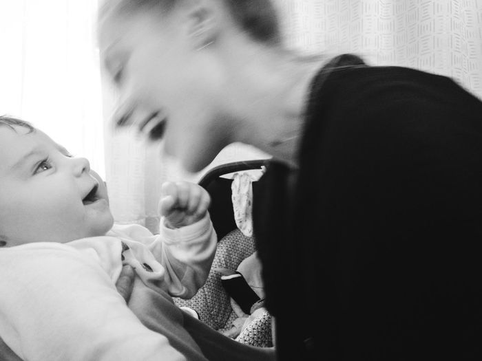 mother and baby having fun Black And White Mother & Daughter Babyhood Cheerful Happiness Laughing Smiling Child Childhood Parent Young Family Baby Real People Togetherness People Headshot Love Positive Emotion