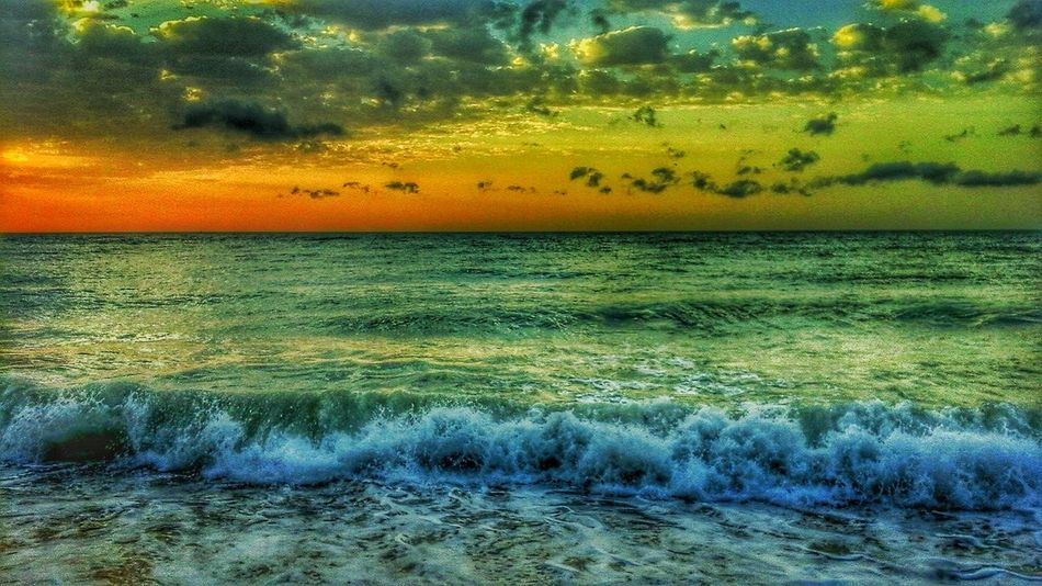 🌞🌞☁☁⛅⛅ Sea Nature Sunset Beauty In Nature Water Backgrounds No People Outdoors Reflection Beach Full Frame Scenics Tranquility Wave Yellow Sky Day Close-up High Angle View Tranquil Scene EyeEmNewHere Eyem Select HelloEyeEm Travel Destinations