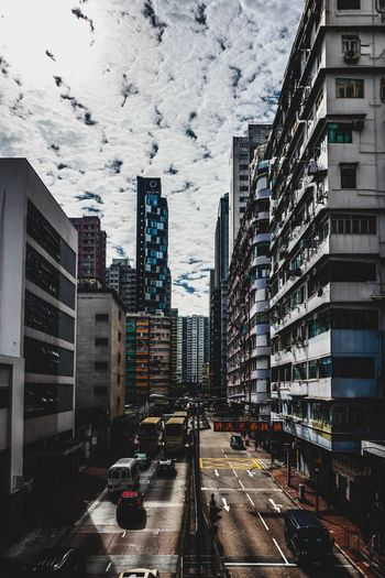 Clouds Reframinghk Street Photography Discoverhongkong Architecture Building Exterior Built Structure City Building Motor Vehicle Car Land Vehicle Mode Of Transportation Transportation Street Road Office Building Exterior City Street Tall - High Day Nature Residential District Cityscape Skyscraper