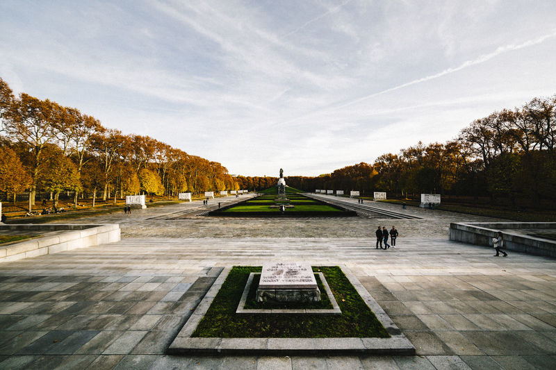 Soviet Memorial Treptow Autumn Autumn Colors Berlin Day Field Grass Historical Historical Building Historical Monuments History Landscape Leading Memorial Mid Distance Monuments Narrow Outdoors Place Rural Scene Sky Stone The Way Forward Tree Treptow Warm