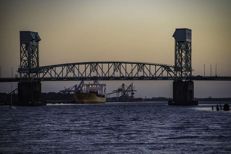 "Sunset shot from Riverwalk looking towards the USS North Carolina BB-55 ""THE SHOWBOAT"" Moon Moon Shots Moonlitsunset NCPhotographer Nikon Nikond750 Portcitylowlife Riverwalk Downtown Showboat Tamrom28300 ThroughMyLens Wilmington NC Bridge - Man Made Structure Carolinas Moon Surface Moonlight Nature No People Outdoors Portcity Sky Sunset #sun #clouds #skylovers #sky #nature #beautifulinnature #naturalbeauty #photography #landscape Sunsets Ussnorthcarolina Waterfront"