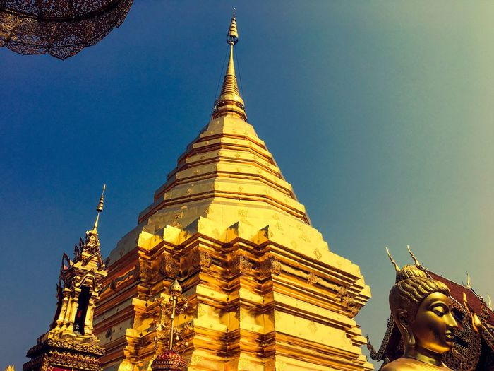 Thailand Religion Spirituality Place Of Worship Architecture Gold Colored Pagoda Built Structure Gold Statue Building Exterior Travel Destinations No People Low Angle View Golden Color Golden Outdoors Sky Sculpture Clear Sky Day