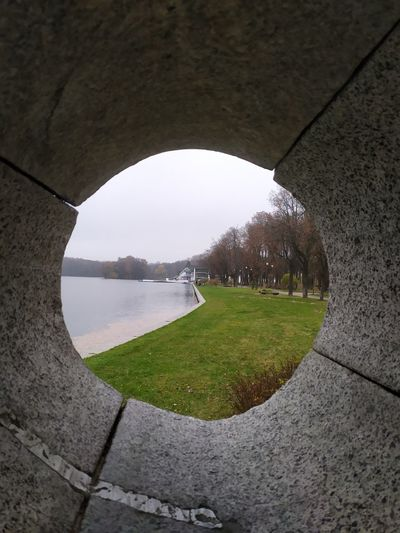 Scenic view of arch seen through hole