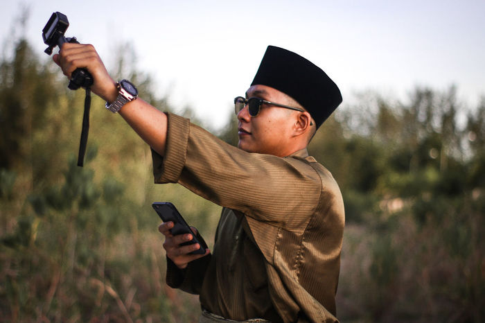 GoProHero6 Aidilfitri Photohunting GoProhero6 Canonphotography Tree Sportsman Men Weapon Warm Clothing Camouflage Clothing Mid Adult Shooting A Weapon Mid Adult Men Sky