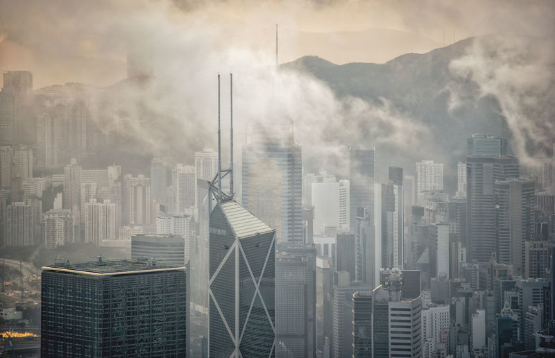 Aerial view over foggy hong kong city