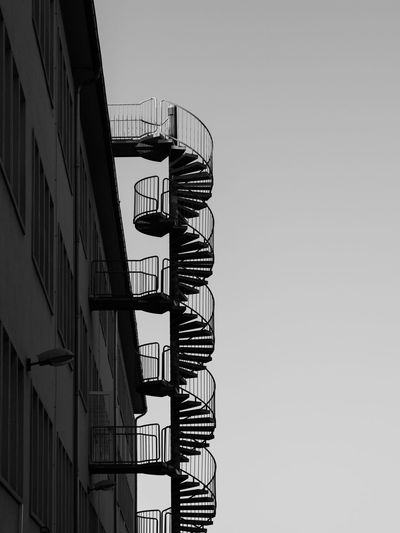 Low Angle View Of Spiral Staircase Of Building Against Clear Sky