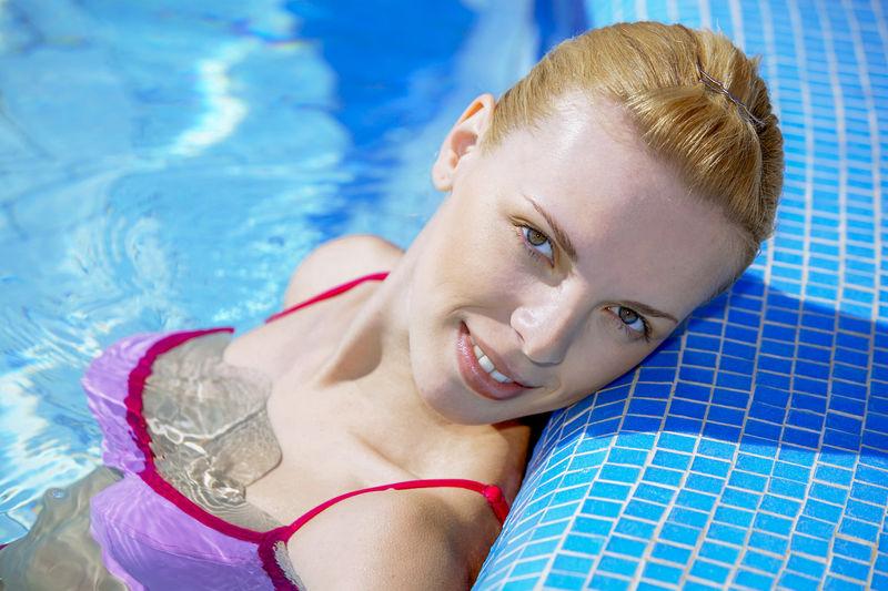 Close-Up Portrait Of Woman Wearing Bikini In Swimming Pool
