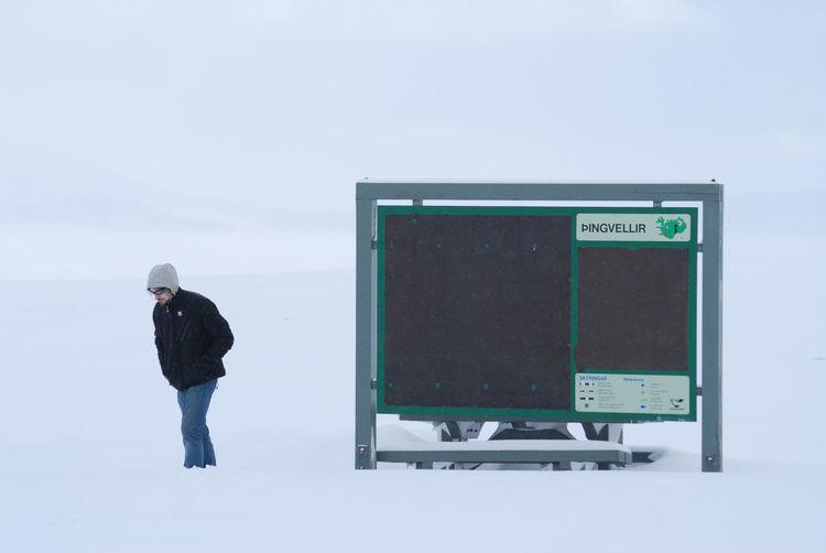 Full length of man standing on snow against sky