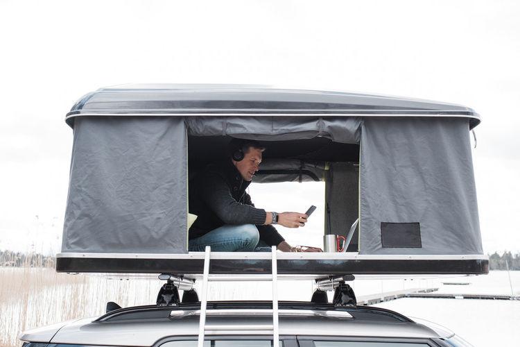 Man sitting on mobile phone