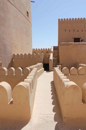 Nizwa Fort Castle in Oman Arabian Architecture Castle Nizwa Fort Oman Arab Arabic Architecture Day Fortress Nizwa Oman_photo Oman_photography Sandstone