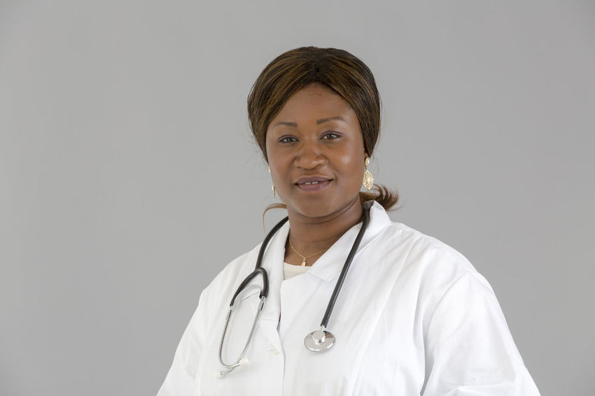 Self Confident Reassuring Posing Self Confidence Trust Reassure Selfconfident Looking To The Camera Front View Reassurance Looking At Camera Clinic White Background Doctor  Nurse Pediatrics Hospital Pediatrician Stethoscope  Portrait African African Girl  Beautiful Woman Medical Occupation