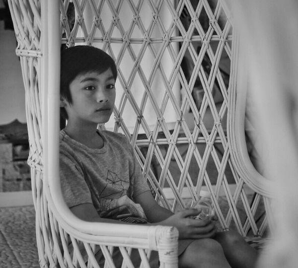 Boy sitting outdoors