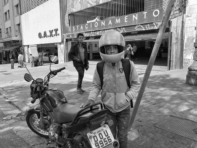 """Space Oddity"". July, 2017 Streetphotography Motorcycle Transportation Full Length Land Vehicle Day Helmet Headwear Childhood Outdoors One Person People Adult Adults Only"