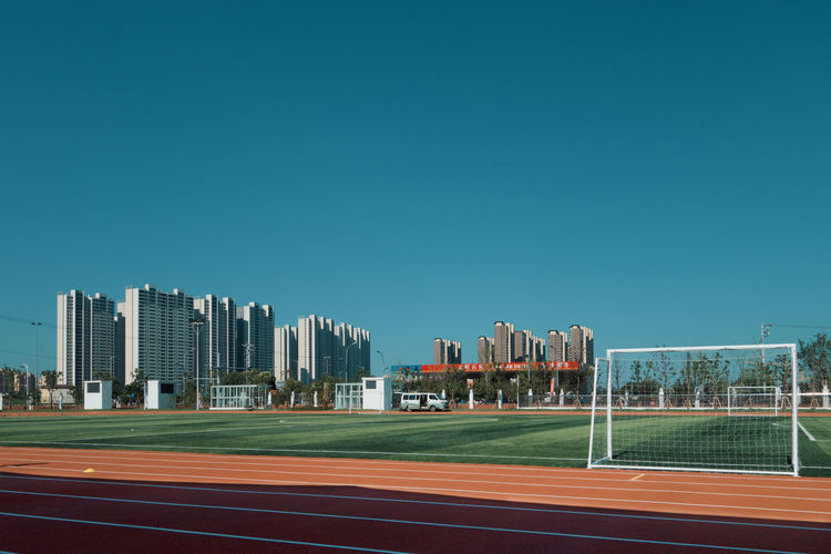 Architecture Building Building Exterior Built Structure China City Clear Sky Copy Space Day Football Field No People Office Building Exterior Outdoors Playing Field Sky Skyscraper Soccer Field Sport Sports Track Sunlight Suzhou Track And Field