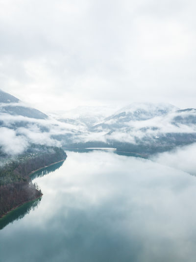 Sylvensteinspeicher captured with a drone. Bayern, Germany. My Best Photo Cloud - Sky Sky Beauty In Nature Tranquility Scenics - Nature Tranquil Scene Day Nature No People Fog Outdoors Sylvensteinspeicher Lake Drone  Dronephotography Lake View Forest Wood And Water Blue Water Water Reflections Mountain Mountain Range Cloudscape