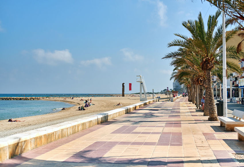 El Campello, Spain - May 22, 2018: People walking along the seafront palm-lined promenade in El Campello. Alicante, Costa Blanca, Spain Alicante Alicante, Spain City Costa Blanca El Campello Footpath Pedestrian Walkway Promenade SPAIN Sidewalk Beach El Campello Spain Footpath Landscape Nature Outdoors Palm Tree Pedestrian Resort Sandy Beach Seafront Seaside Sky Walkway Waterfront